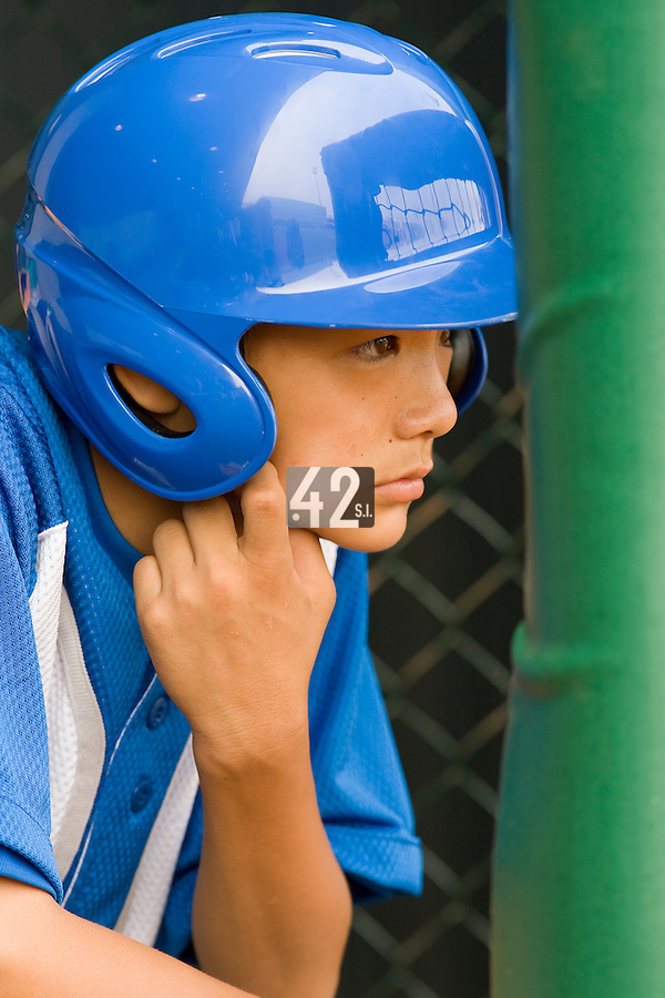 18 August 2007: A chinese batboy is seen next to the dugout prior to the China 5-1 victory over France in the Good Luck Beijing International baseball tournament (olympic test event) at the Wukesong Baseball Field in Beijing, China.