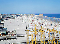 Wildwood NJ Boardwalk & Wild Mouse Ride. Large wide beach seen from the air.