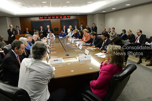 This handout photo shows United States Secretary of State Hillary Rodham Clinton's first day back at work at the State Department in Washington, D.C. following her recent illness. Here, Secretary Clinton, right, is participating in a meeting of the Assistant Secretaries of State.  According to her spokesperson, the Secretary was greeted by cheers, a standing ovation and a gag gift of protective headgear as she returned from a month-long recovery from a series of illnesses including a stomach virus, a fall and a concussion, and a brief hospitalization for a blot clot near her brain. .Credit: Department of State via CNP