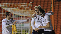 Cameron McGeehan (centre) celebrates his goal during the Sky Bet League 2 match between Blackpool and Luton Town at Bloomfield Road, Blackpool, England on 17 December 2016. Photo by Liam Smith.