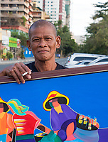 General life and environs in the Malate, Manila area and Manila Bay, Philippines. A local Filipino vendor selling his Paintings, Manila, Philippines