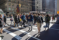 Visitors and workers in the Garment District in New York at an intersection on Friday, October 14, 2016.  (© Richard B. Levine)