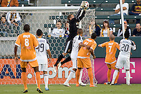 LA Galaxy goalkeeper Josh Saunders (12) leaps high for save. The Puerto Rico Islanders defeated the LA Galaxy 4-1 during CONCACAF Champions League group play at Home Depot Center stadium in Carson, California on Tuesday July 27, 2010.