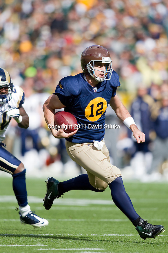 Green Bay Packers quarterback Aaron Rodgers (12) scrambles for yardage during a Week 6 NFL football game against the St. Louis Rams on October 16, 2011 in Green Bay, Wisconsin. The Packers won 24-3. (AP Photo/David Stluka)