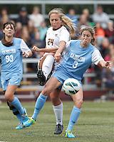 Boston College forward Rachel Davitt (24) and University of North Carolina defender Megan Brigman (3) battle for crossed ball.   University of North Carolina (blue) defeated Boston College (white), 1-0, at Newton Campus Field, on October 13, 2013.