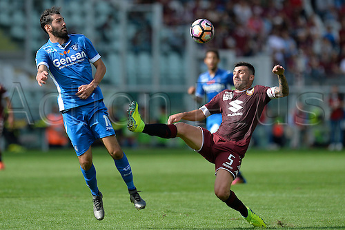 19.09.2016. Stadio Olimpico, Torino, Italy. Serie A Football. Torino versus Empoli. A temporary defence from Cesare Bovo avoids the high tackle from Riccardo Saponara