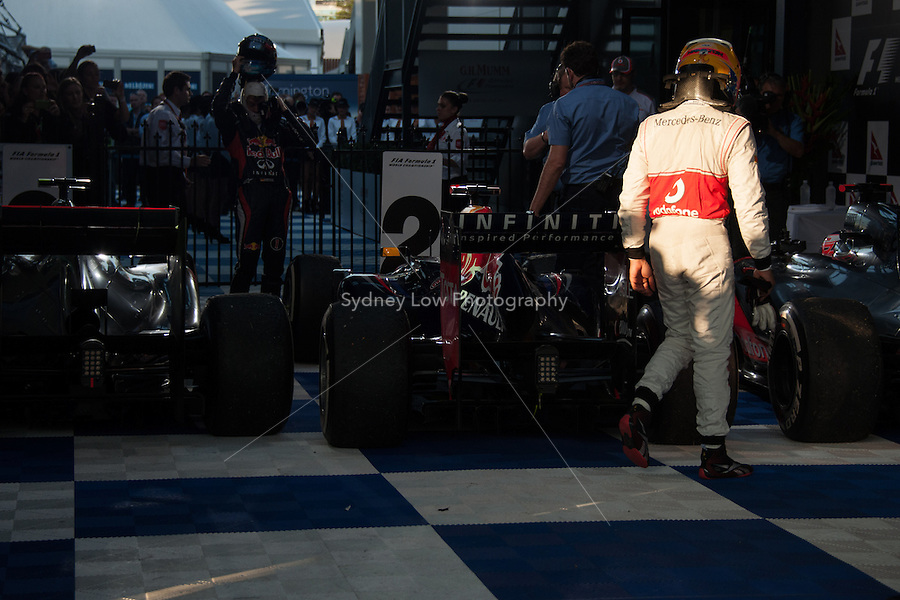 MELBOURNE, 18 March - Lewis Hamilton of the Vodafone McLaren Mercedes Team walks over to congratulate his team mate Jenson Button on winning the 2012 Formula One Australian Grand Prix at the Albert Park Circuit in Melbourne, Australia. (Photo Sydney Low / syd-low.com)