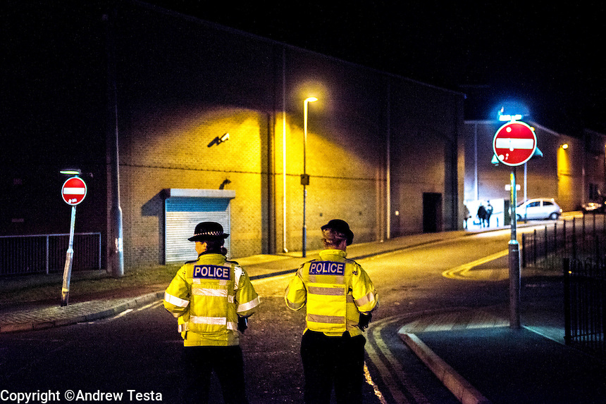 UK. Northampton. 7th December 2013<br /> Policewomen Amy Lovell (left) and Lisa Pickersgill patrol the backstreets of Northampton.<br /> &copy;Andrew Testa for the New York Times
