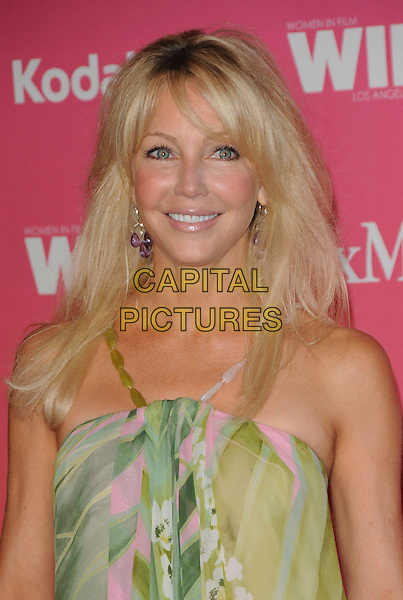 HEATHER LOCKLEAR .at The Women in Film 2009 Crystal .and Lucy Awards held at The Hyatt Regency Century Plaza in Century City, California, USA, June 12th 2009                                                                     .portrait headshot green pink print straps fringe beads earrings .CAP/DVS.©DVS/RockinExposures/Capital Pictures
