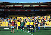 The team captains and match officials line up for the coin toss during the Football United Tour match between Sydney FC and West Ham United at Westpac Stadium, Wellington, New Zealand on Saturday, 26 July 2014. Photo: Dave Lintott / lintottphoto.co.nz