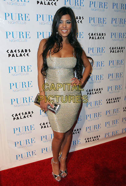 KOURTNEY KARDASHIAN.Khloe Kardashian celebrates her 21st birthday at Pure Night Club inside Caesar's Palace Hotel and Casino, Las Vegas, Nevada, USA,.27 June 2008..full length gold dress tight shiny hand on hip silver clutch bag shoes peep toe ankle strap.CAP/ADM/MJT.©MJT/Admedia/Capital Pictures