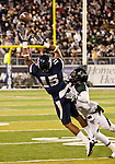 November 12, 2011:Nevada Wolf Pack receiver Rishard Matthews goes high for a pass as Hawaii's Mike Edwards defends during a WAC league game vs Hawaii played at Mackay Stadium in Reno, Nevada.