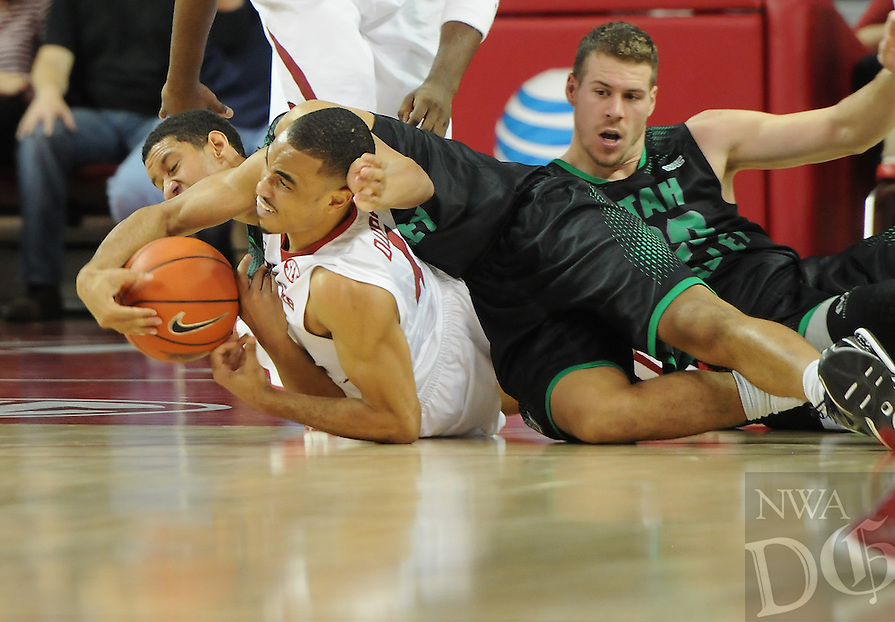 NWA Media/ J.T. Wampler -Arkansas' Jabril Durham fights for possession with Utah Valley's Marcel Davis Saturday Jan. 3, 2015 at Bud Walton Arena in Fayetteville. The Hogs won 79-46.