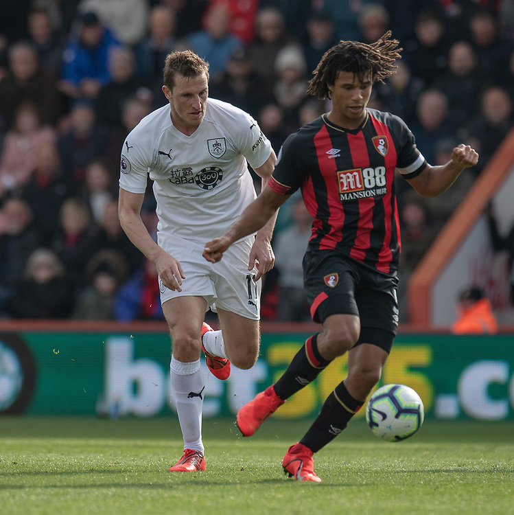 Bournemouth's Nathan Ake (right) under pressure from Burnley's Chris Wood (left) <br /> <br /> Photographer David Horton/CameraSport<br /> <br /> The Premier League - Bournemouth v Burnley - Saturday 6th April 2019 - Vitality Stadium - Bournemouth<br /> <br /> World Copyright © 2019 CameraSport. All rights reserved. 43 Linden Ave. Countesthorpe. Leicester. England. LE8 5PG - Tel: +44 (0) 116 277 4147 - admin@camerasport.com - www.camerasport.com