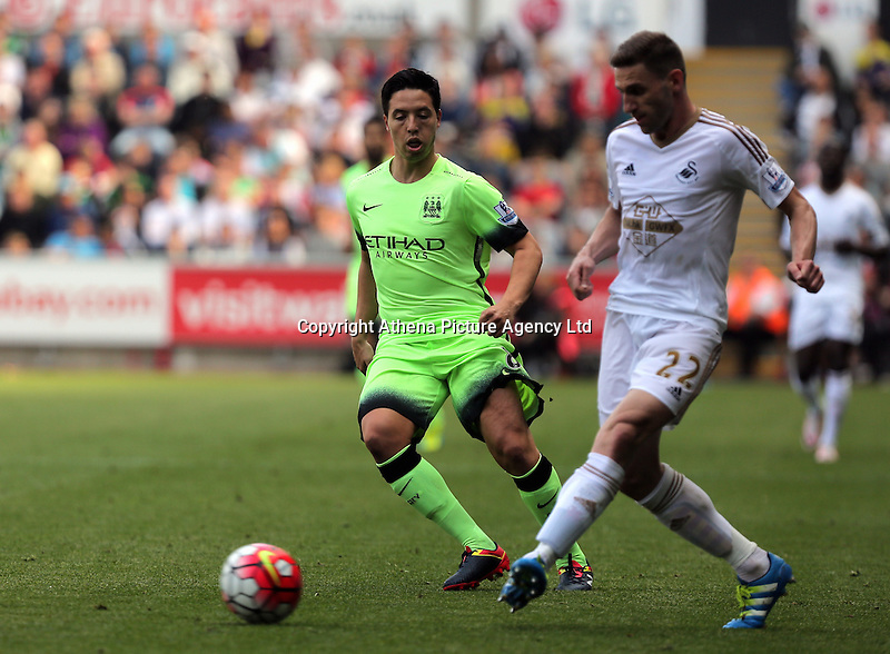 ( L-R ) Samir Nasri of Manchester City against Angel Rangel of Swansea City during the Swansea City FC v Manchester City Premier League game at the Liberty Stadium, Swansea, Wales, UK, Sunday 15 May 2016