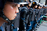 Japanese police in riot gear guard right wingers protesting against a left wing march during the commemoration of the end of the Pacific war at Yasukuni Shrine, Kudanshita, Tokyo, Japan. August 15th 2010