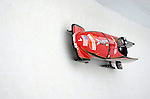 15 December 2007: USA 1 pilot Steve Holcomb with brakeman Curtis Tomasevicz enter turn 17 during their second run at the FIBT World Cup Bobsled Competition at the Olympic Sports Complex on Mount Van Hoevenberg, at Lake Placid, New York, USA. USA 1 came in third to take the Bronze Medal...Mandatory Photo Credit: Ed Wolfstein Photo