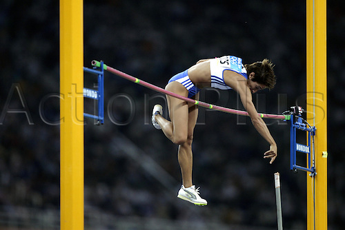 21 August 2004: Greek vaulter Yeoryia Tsiliggiri (GRE) tries to clear the bar during the Women's Pole Vault Qualification held at the Olympic Stadium. 2004 Olympic Games, Athens, Greece. Photo: Neil Tingle/Action Plus...040821 olympics olympic athletics woman women women's jumping jumps leap athlete .female