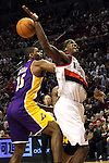 04/08/11-Trailblazers forward Gerlald Wallace is shoved from behind by Lakers' Ron Artest in the 4th quarter of Porland's 93-86 win over L.A. at the Rose Garden..Photo by Jaime Valdez........................................