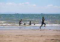 Pictured: Children play in the sea. Saturday 01 July 2017<br />
