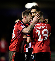 Lincoln City's Tyler Walker, centre, celebrates scoring his side's second goal with team-mates Neal Eardley, left, and Joe Morrell<br /> <br /> Photographer Chris Vaughan/CameraSport<br /> <br /> The EFL Sky Bet League One - Lincoln City v Bolton Wanderers - Tuesday 14th January 2020  - LNER Stadium - Lincoln<br /> <br /> World Copyright © 2020 CameraSport. All rights reserved. 43 Linden Ave. Countesthorpe. Leicester. England. LE8 5PG - Tel: +44 (0) 116 277 4147 - admin@camerasport.com - www.camerasport.com