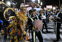 A samba dancer and drummers perform at the Sambadrome during the samba school parade, Rio de Janeiro, Brazil, February 28. 2014. (Austral Foto/Renzo Gostoli)