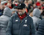 Jurgen Klopp manager of Liverpool smiles after touching elbows with Diego Simeone manager of Atletico Madrid during the UEFA Champions League match at Anfield, Liverpool. Picture date: 11th March 2020. Picture credit should read: Darren Staples/Sportimage