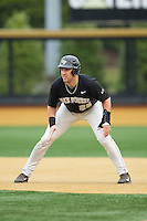 Matt Conway (25) of the Wake Forest Demon Deacons takes his lead off of first base against the Florida State Seminoles at Wake Forest Baseball Park on April 19, 2014 in Winston-Salem, North Carolina.  The Seminoles defeated the Demon Deacons 4-3 in 13 innings.  (Brian Westerholt/Four Seam Images)