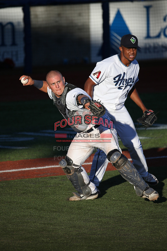 Daulton Varsho (21) of the Hillsboro Hops throws to first base after fielding a bunt during a game against the Spokane Indians at Ron Tonkin Field on July 22, 2017 in Hillsboro, Oregon. Spokane defeated Hillsboro, 11-4. (Larry Goren/Four Seam Images)