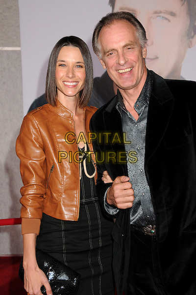 """GUEST & KEITH CARRADINE .""""Old Dogs"""" Los Angeles Premiere held at the El Capitan Theatre, Hollywood, California, USA, 9th November 2009..half length black brown tan leather jacket smiling grey gray silver shirt .CAP/ADM/BP.©Byron Purvis/AdMedia/Capital Pictures."""
