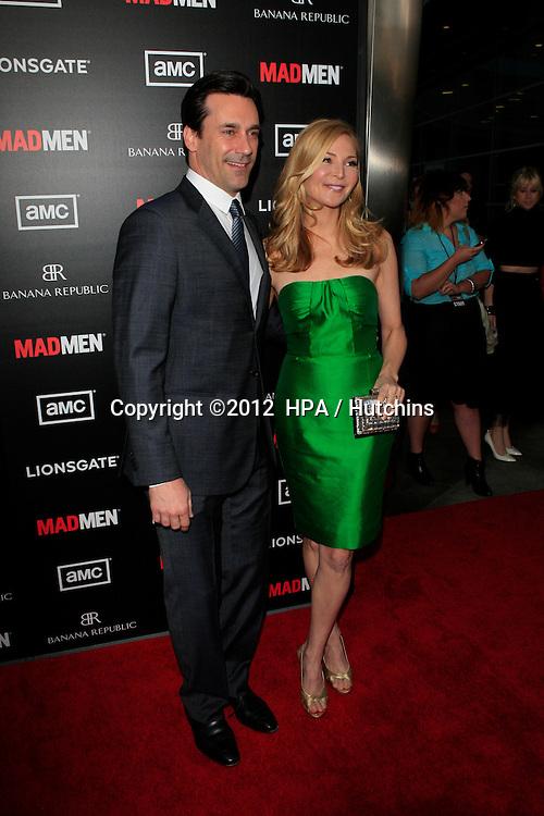 "LOS ANGELES - MAR 14:  Jon Hamm; Jennifer Westfeldt arrives at the ""Mad Men"" Season 5 Premiere Screening at the ArcLight Theaters on March 14, 2012 in Los Angeles, CA"