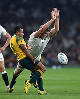 Will Genia of Australia looks to box-kick the ball as Joe Launchbury of England attempts to charge him down. Rugby World Cup Pool A match between England and Australia on October 3, 2015 at Twickenham Stadium in London, England. Photo by: Patrick Khachfe / Onside Images