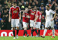 Wayne Rooney of Manchester United celebrates scoring his goal to make it 2-1 with Anthony Martial during the Barclays Premier League match between Manchester United and Swansea City played at Old Trafford, Manchester on January 2nd 2016