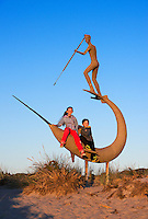 Siblings pose with Harpooner sculpture on a family vacation, Martha's Vineyard.