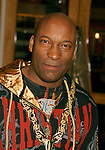 """UNIVERSAL CITY, CA. - March 12: John Singleton arrives at the Los Angeles premiere of """"Fast & Furious"""" at the Gibson Amphitheatre on March 12, 2009 in Universal City, California."""