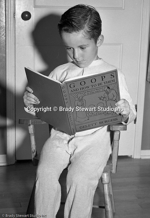 "Pleasant Hills PA:  Brady Stewart Studio participated in a national promotion for American Hardware Catalog Cover - 1950.  The contest asked for submissions to include a child reading a book at night time.  In this image, Thomas Crossland is reading the ""Goops and how to be them""."