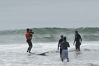 Surfer's Healing with Autistic children riding waves at Wrightsville Beach, NC
