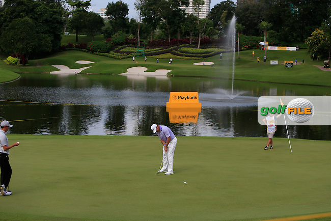 Lee Westwood (ENG) on the 14th green during Round 1 of the Maybank Malaysian Open at the Kuala Lumpur Golf &amp; Country Club on Thursday 5th February 2015.<br />