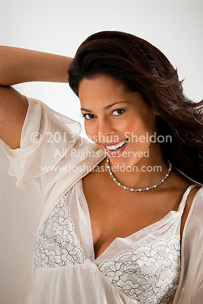 Portrait of beautiful Hispanic woman, looking forward, smiling