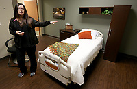 NWA Democrat-Gazette/DAVID GOTTSCHALK  Alexi McClellan, registered sleep technician at the Washington Regional Center for Sleep Disorders, describes Friday, September 6, 2019, one of the new sleep rooms at the center in Fayetteville. The center has expanded from six to ten beds.