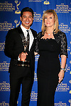 BEVERLY HILLS - JUN 22: Mario Lopez, Lisa Gregorisch-Dempsey at The 41st Annual Daytime Emmy Awards Press Room at The Beverly Hilton Hotel on June 22, 2014 in Beverly Hills, California