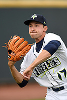 Starting pitcher Jake Simon (17) of the Columbia Fireflies warms up before a game against the Augusta GreenJackets on Saturday, April 7, 2018, at Spirit Communications Park in Columbia, South Carolina. Augusta won, 6-2. (Tom Priddy/Four Seam Images)