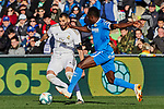 Karim Benzema of Real Madrid and Djene Dakoman of Getafe FC during La Liga match between Getafe CF and Real Madrid at Coliseum Alfonso Perez in Getafe, Spain. January 04, 2020. (ALTERPHOTOS/A. Perez Meca)