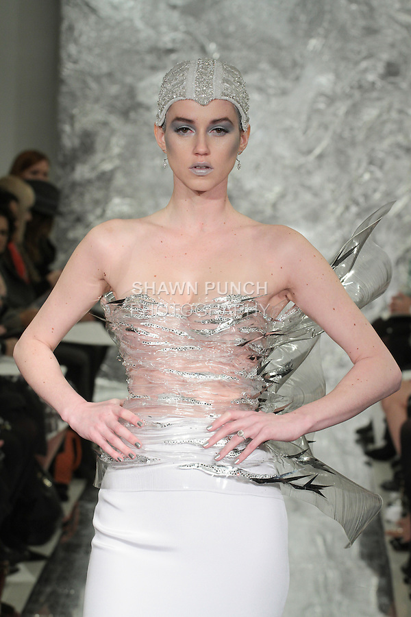 Model Caitlin Lyon walks runway in Neyteri - a molded crystal corset over white silk crepe skirt, from the Theia Spring 2017 bridal collection by Don O'Neill in collaboration with Miodrag Guberinic, during New York Bridal Fashion Week Spring Summer 2017 on April 14, 2016.