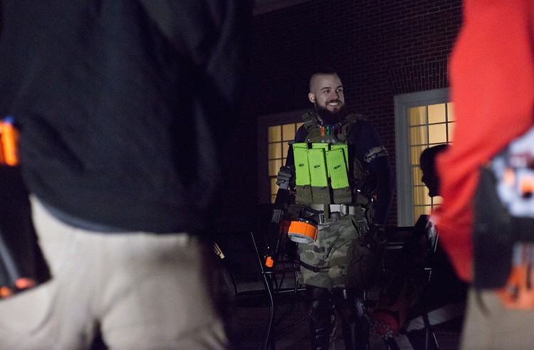 Anthony Rohn, one of the Humans vs. Zombies mediators, speaks to the game's humans before the start of the night's mission on March 22, 2017.