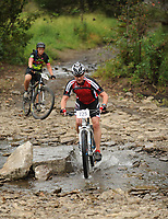 NWA Democrat-Gazette/ANDY SHUPE<br /> Mike Glaysher of Bentonville rides across Lee Creek Saturday, Sept. 19, 2015, during the Northwest Arkansas Mountain Bike Championships at Devil's Den State park.