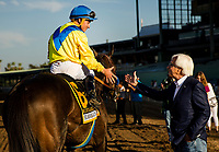 ARCADIA, CA - SEPTEMBER 30: Drayden Van Dyke shakes the hand of trainer Bob Baffert after winning the Awesome Again Stakes aboard Mubtaahij #6 at Santa Anita Park on September 30, 2017 in Arcadia, California. (Photo by Alex Evers/Eclipse Sportswire/Getty Images)