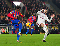 Crystal Palace's Wilfried Zaha vies for possession with Burnley's Steven Defour<br /> <br /> Photographer Ashley Crowden/CameraSport<br /> <br /> The Premier League - Crystal Palace v Burnley - Saturday 13th January 2018 - Selhurst Park - London<br /> <br /> World Copyright &copy; 2018 CameraSport. All rights reserved. 43 Linden Ave. Countesthorpe. Leicester. England. LE8 5PG - Tel: +44 (0) 116 277 4147 - admin@camerasport.com - www.camerasport.com