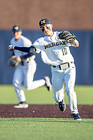 Michigan Wolverines third baseman Blake Nelson (10) makes a throw to first base against the Rutgers Scarlet Knights on April 26, 2019 in the NCAA baseball game at Ray Fisher Stadium in Ann Arbor, Michigan. Michigan defeated Rutgers 8-3. (Andrew Woolley/Four Seam Images)