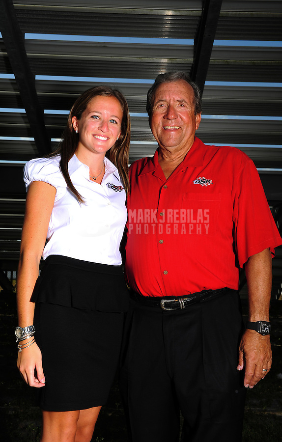 Jan. 18, 2012; Jupiter, FL, USA: NHRA team owner Don Schumacher (right) and daughter Megan Schumacher pose for a portrait during testing at the PRO Winter Warmup at Palm Beach International Raceway. Mandatory Credit: Mark J. Rebilas-